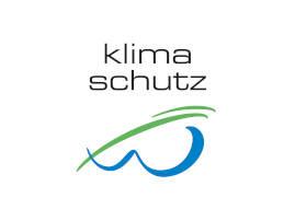 Das Bild zeigt das Wipperfürther Klimaschutzsiegel. Geschwungenes blaues W mit grünem Strich oberhalb und Schriftzug: Klimaschutz